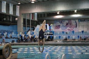 Emily Grund dives at the home swim meet vs South Carolina on Friday, Oct. 26, 2018.