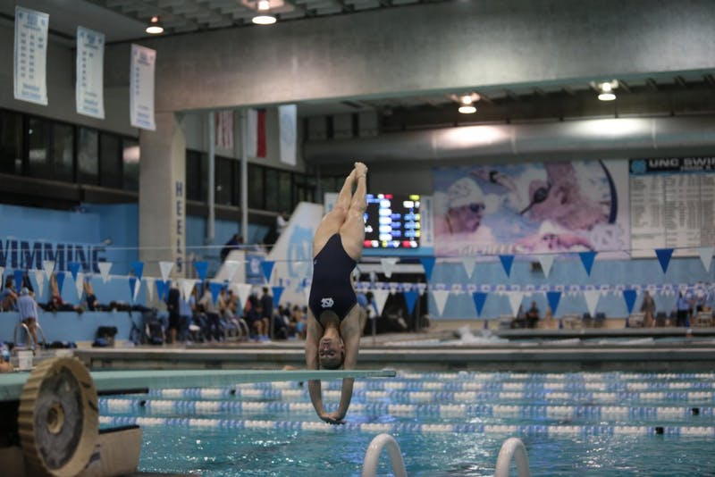Emily Grund dives at the home swim meet vs South Carolina on Friday, Oct. 26, 2018.