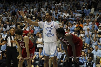 Junior forward Garrison Brooks (15) signals during the game against N.C. State in the Smith Center on Tuesday, Feb. 25, 2020. UNC beat N.C. State 85-79.