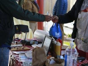 Carborro residents shop at the Carborro farmer's market Saturday, Feb. 9 2020.