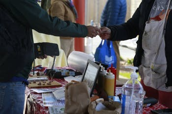 Carborro residents shop at the Carborro farmer's market Saturday, Feb. 9 2020.