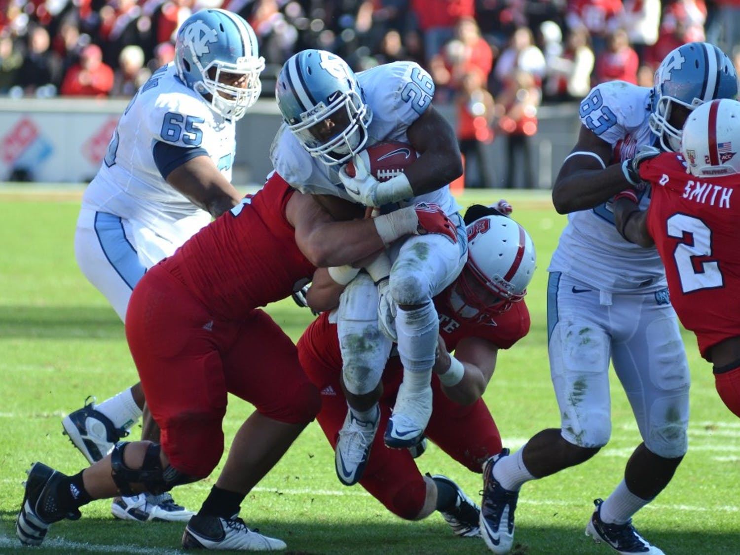 UNC running back Giovani Bernard fights for extra yards against the Wolfpack defense in UNC's 13-0 loss to NC State at Carter-Finley Stadium in Raleigh, NC.