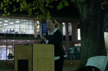 UNC LGBTQ Center Assitant Director April Callis reads the names of trans people who have lost their lives in the past year. The UNC LGBTQ Center held a candlelight honoring the lives of trans people who have died in the past year in the Pit on Wednesday, Nov. 20, 2019.