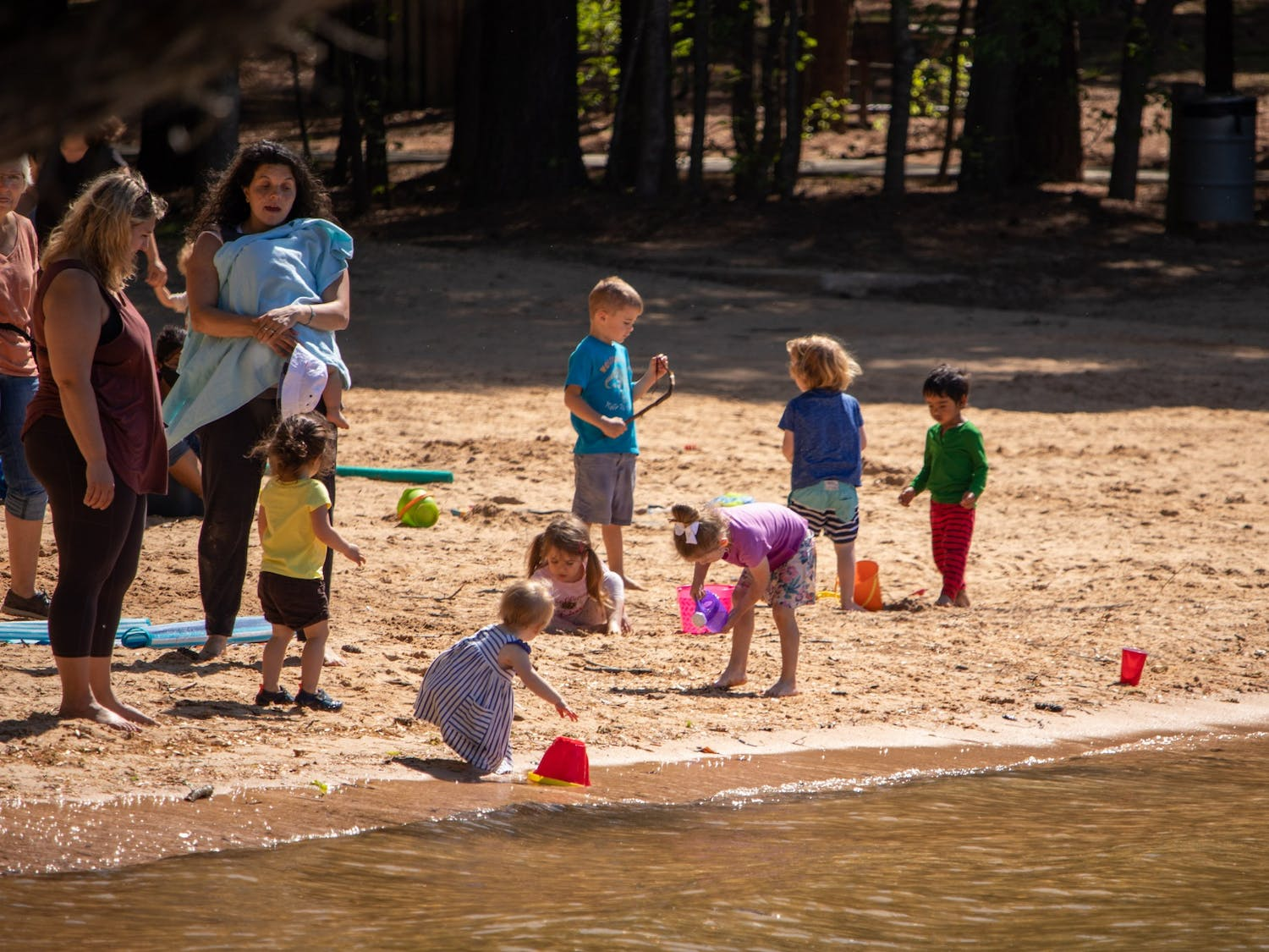 Families join together to enjoy the warm weather at Jetton Park in Cornelius, NC on Monday, April 12, 2021.