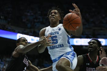 UNC's freshman forward Armando Bacot (5) attempts to shoot a basket during a game against Gardner-Webb on Friday, Nov. 15, 2019. UNC beat Gardner Webb 77-61.