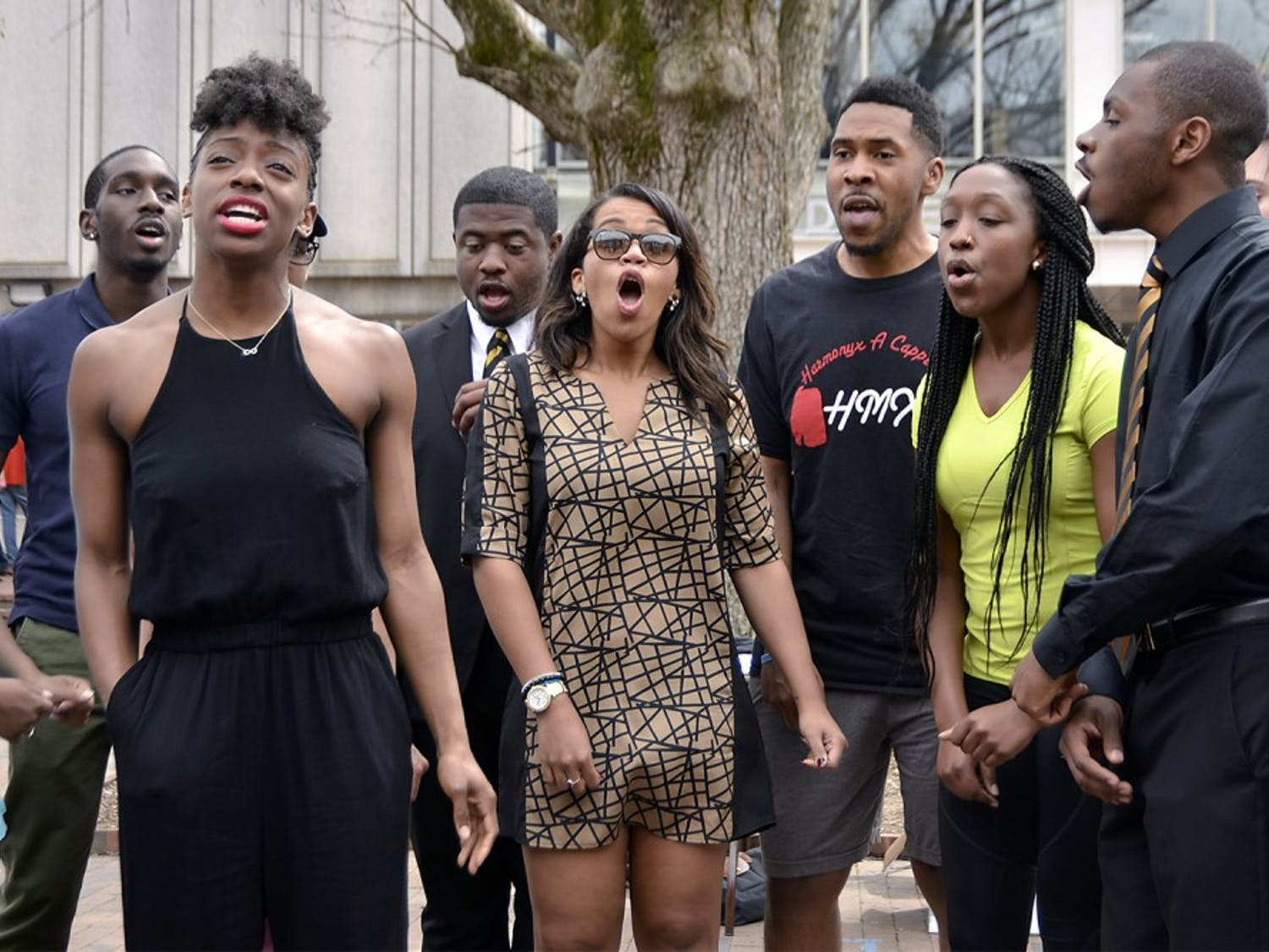 """Harmonyx, an acapella group on campus, is celebrating their 20th anniversary this Friday with a concert. Erika Baker, a senior biology major, sings a new song in the pit on Friday afternoon. She explained that the best part of Harmonyx is """"hanging out with some really great, genuine people."""""""
