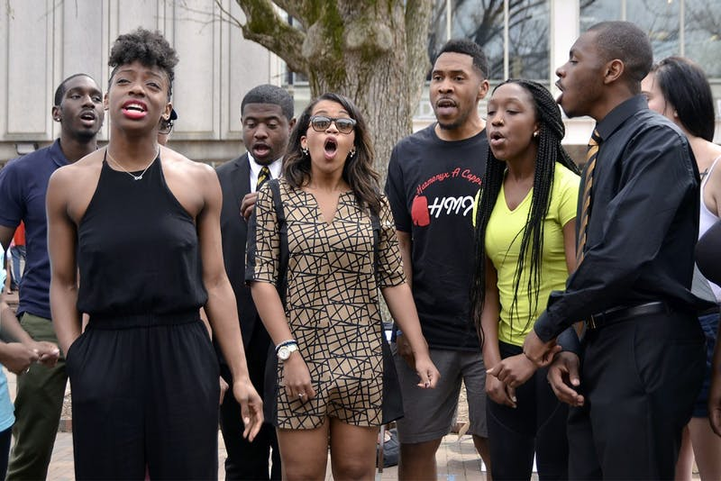 "Harmonyx, an acapella group on campus, is celebrating their 20th anniversary this Friday with a concert. Erika Baker, a senior biology major, sings a new song in the pit on Friday afternoon. She explained that the best part of Harmonyx is ""hanging out with some really great, genuine people."""