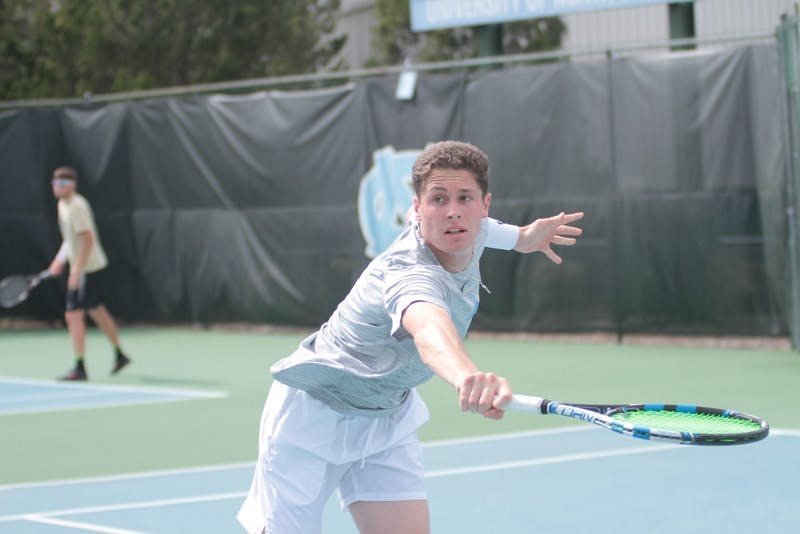 Junior Blaine Boyden competes against Wake Forest on March 28 at the Cone-Kenfield Tennis Center.