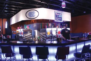 Bartender Magnus Ellington works at Zell's Underground Daiquiri Bar, open Thursday through Sunday.