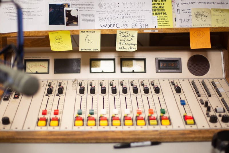 The WXYC station's mixing board sits on the main room of the station.
