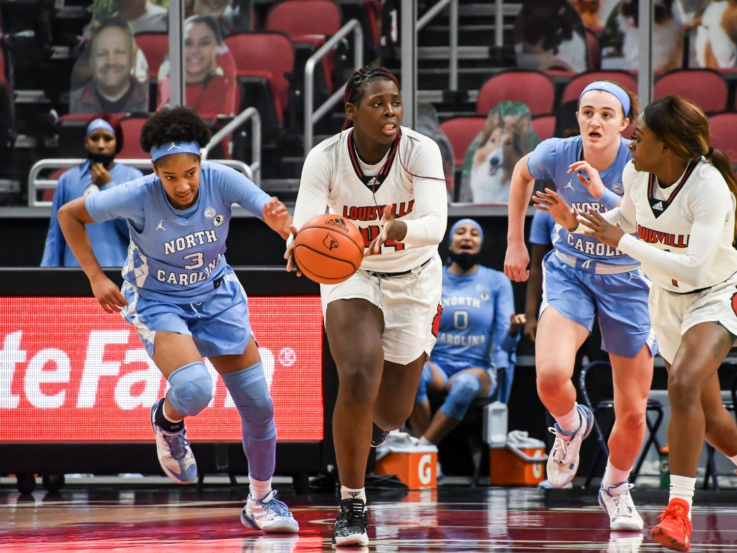 Louisville's first-year forward Olivia Cochran (44) attempts to pass to senior guard Dana Evans (1) during a game against UNC on Thursday, Jan. 28, 2021. UNC fell to the Cardinals 68-79. Photo courtesy of Jared Anderson.