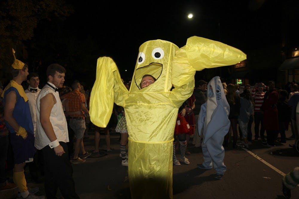 "Halloween festivities on Franklin Street: Senior Matthew Sparks (Management Society) dressed up as an ""Air Dancer"""
