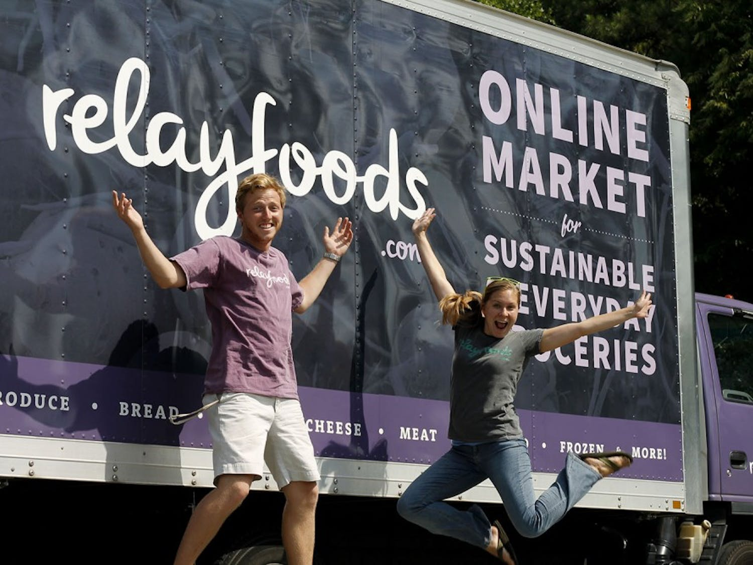 Employees Cheryssa Jensen and Matthew Zachrich run one of the pickup stations for the online grocery store Relay Foods in Chapel Hill.