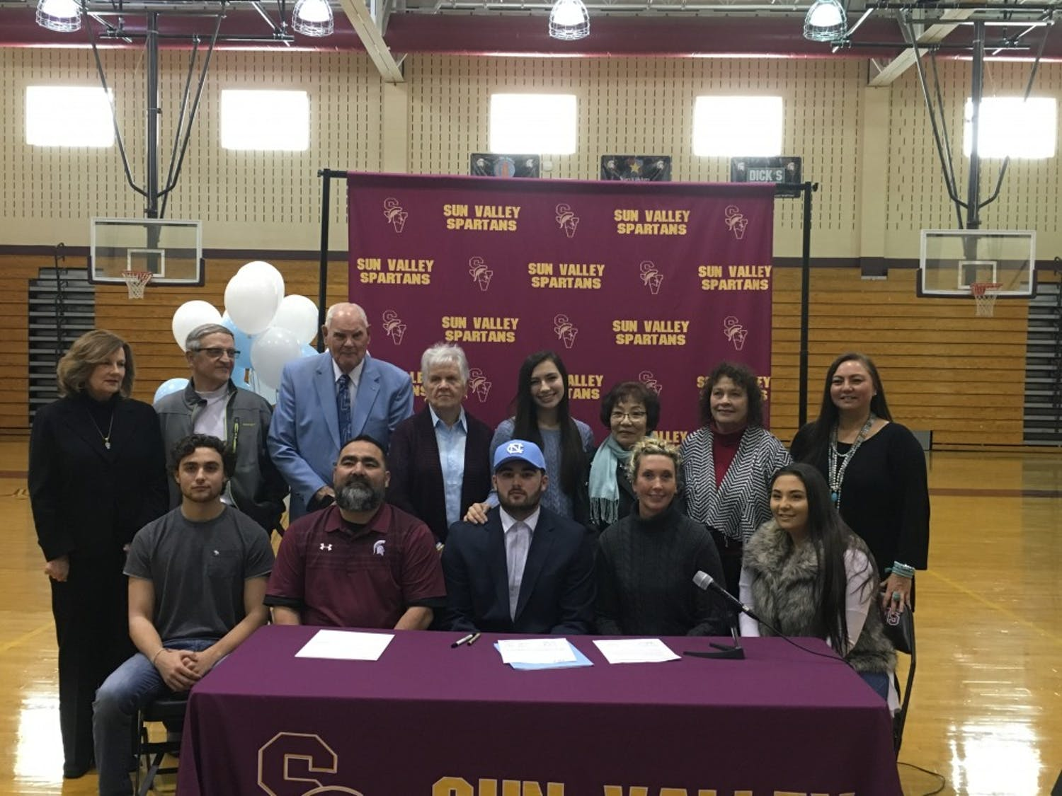 Sam Howell and his family pose at Sun Valley High School in Monroe, after the 2019 four-star quarterback committed to UNC, flipping from Florida State.