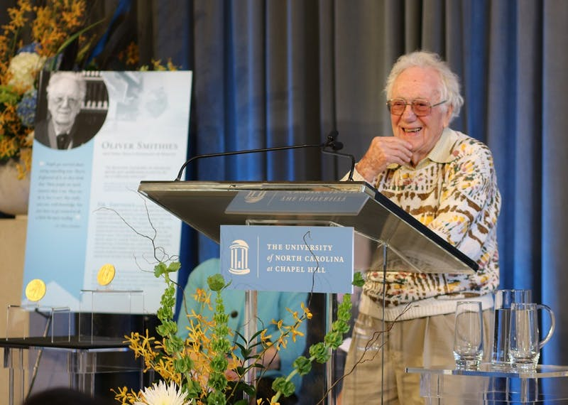 Dr. Smithies, Nobel Prize winner and UNC professor, spoke at a ceremony in Davis library honoring his and Dr. Sancar's achievements, a fellow UNC professor and Nobel Prize winner.