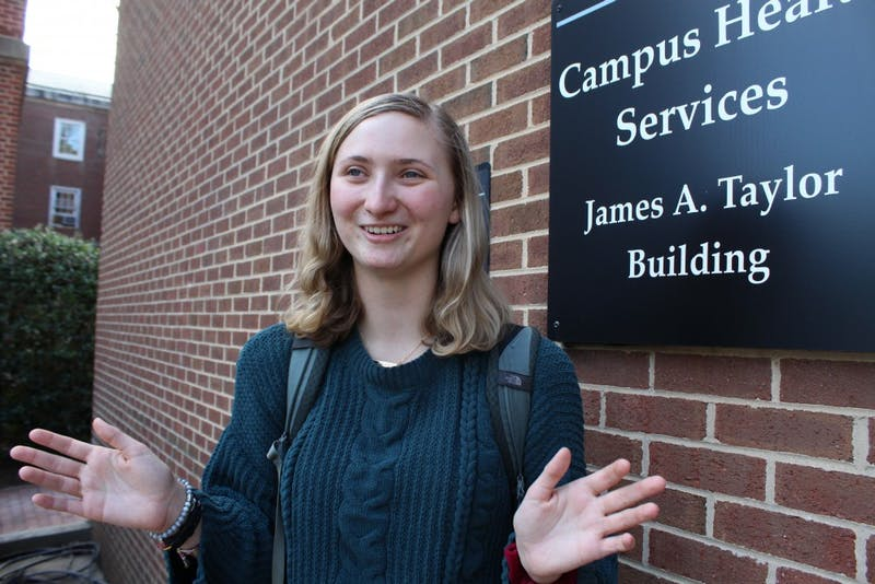 "Eleanor Murray, a first-year public policy and global studies major, at the James A. Taylor Building, where Counseling and Psychological Services is located, on Tuesday, Jan. 8, 2019.  ""As someone who did not realize I had mental health issues, it was helpful and resourceful and I felt supported while trying to find a therapist,"" Murray says of her experience with CAPS. Murray would recommend CAPS and likes the multiple treatment options offered at CAPS."