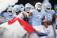 The North Carolina football team runs out of the tunnel against Western Carolina on Saturday in Kenan Stadium.