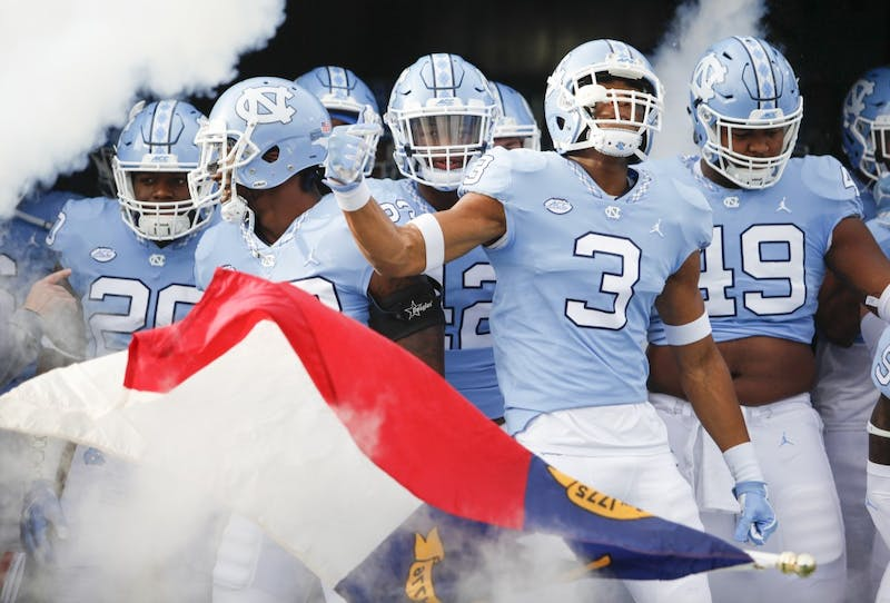 The North Carolina football team runs out of the tunnel against Western Carolina on Saturday in Kenan Stadium.