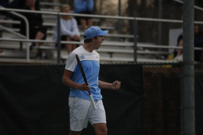 First-year Brian Cernoch, undeclared major, played for the UNC men's tennis team against Duke on Thursday, Feb. 28, 2019 at the Cone-Kenfield Center. UNC won 4-1. Cernoch celebrates after his singles match win.