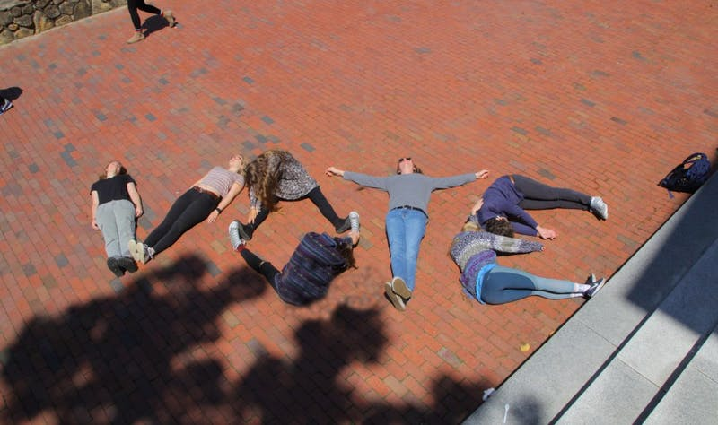 A handful of students — including first-years Becca Brandes, Molly Cartwright and Helen Hill — spelled it out for their peers in front of Polk Place.