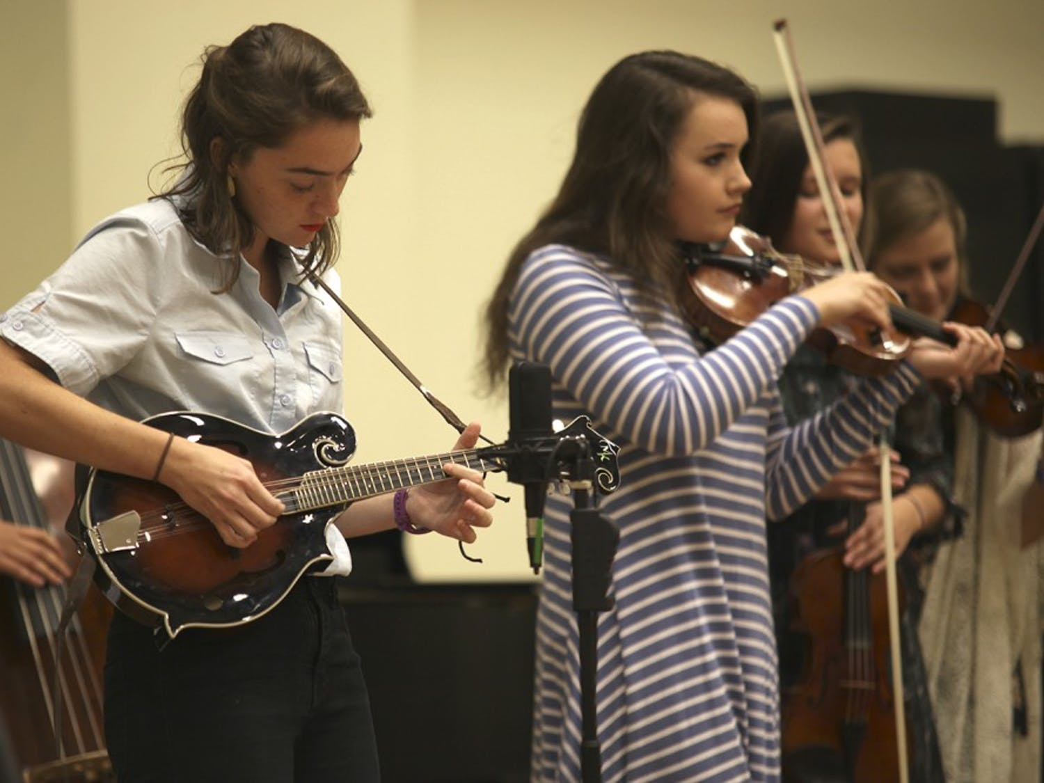 Maddie Fisher plays mandolin for the Carolina Blue Grass Band during a concert Thursday evening.
