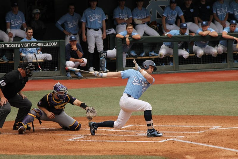 Sophomore Michael Busch (15) swings against East Carolina on Feb. 25 at Boshamer Stadium.