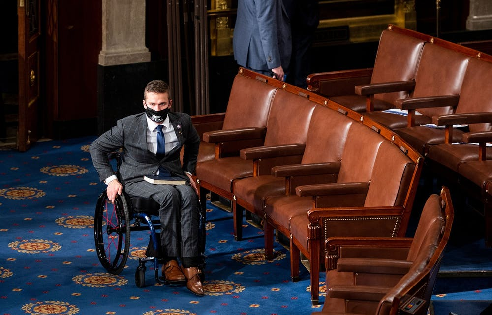 Rep. Madison Cawthorn, R-N.C., arrives on the House floor in the U.S. Capitol before being sworn in on Jan. 3, 2021, in Washington, D.C.,. Photo courtesy of Bill Clark/AFP via Getty Images.