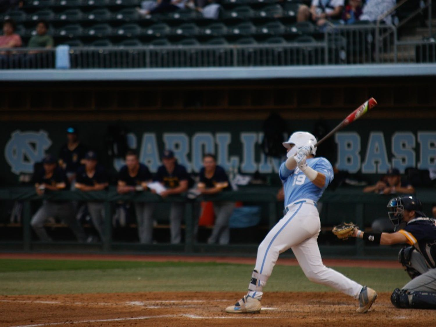 UNC first year desiganted hitter Aaron Sabato (19) swings for the fences against UNCG in Boshamer Stadium on Wednesday, April 9, 2019.