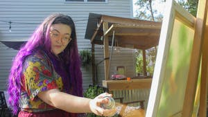 """Sarah Booth, a former student at School of the Art Institute of Chicago, spends her evening testing out new art mediums in her backyard. """"Lately I've been doing things a little non-traditional and I love it,"""" she said."""