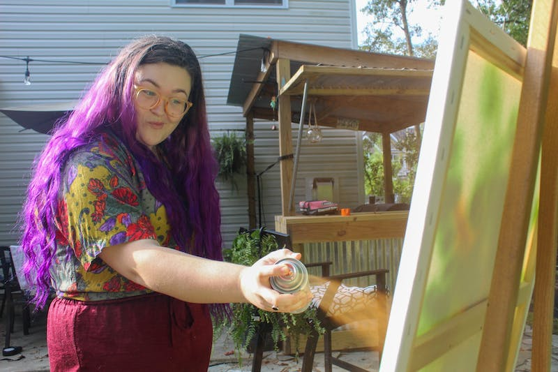 "Sarah Booth, a former student at School of the Art Institute of Chicago, spends her evening testing out new art mediums in her backyard. ""Lately I've been doing things a little non-traditional and I love it,"" she said."