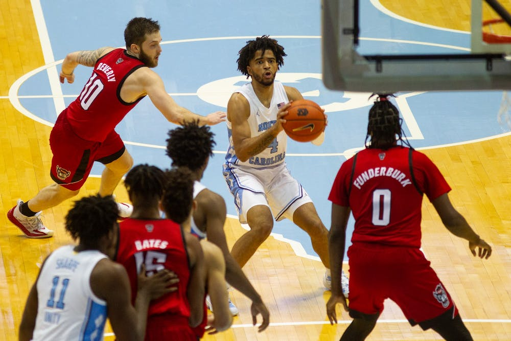 UNC first year guard RJ Davis (4) prepares to take a shot in the Smith Center during a game against NC State on Saturday, Jan. 23, 2021. UNC beat NC State 86-76.