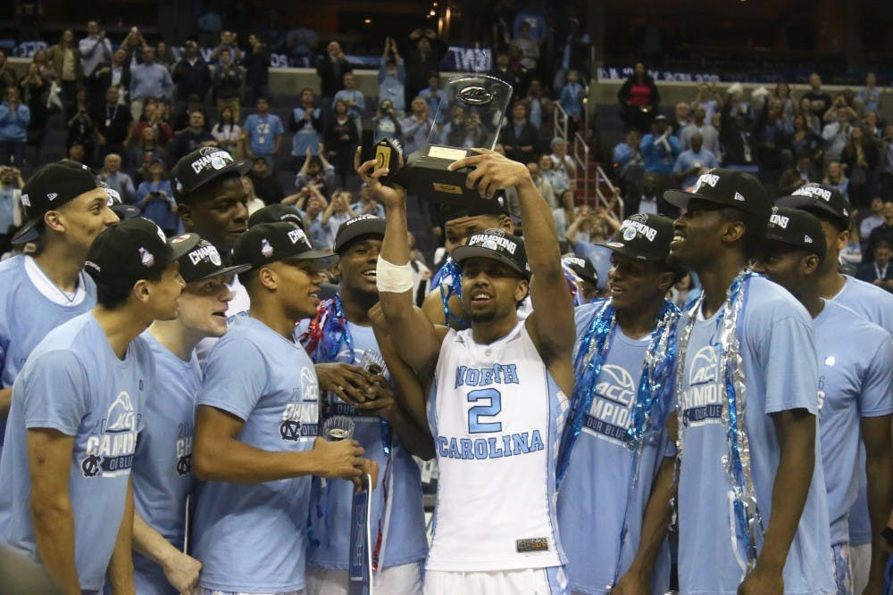 <p>North Carolina guard Joel Berry II (2) hoists up the ACC Championship MVP&nbsp;trophy after the UNC men's basketball team defeated Virginia 61-57 in the ACC Championship game Saturday.</p>