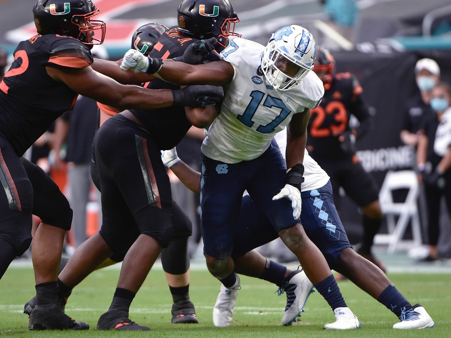 UNC sophomore linebacker Chris Collins (11) drives upfield during a game against Miami in Hard Rock Stadium on Saturday, Dec. 12, 2020. UNC beat Miami 62-26. Photo courtesy of Jeff Camarati via UNC Athletic Communications.