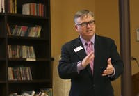 Tim Gaudette, an outreach manager of Small Business Majority, gave a presentation to a round-table of Chapel Hill and Carrboro small business owners at Flyleaf Books.