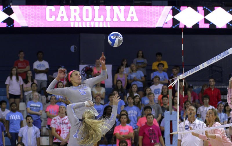 Paige Neuenfeldt spikes the ball for another point on Friday, Oct. 9