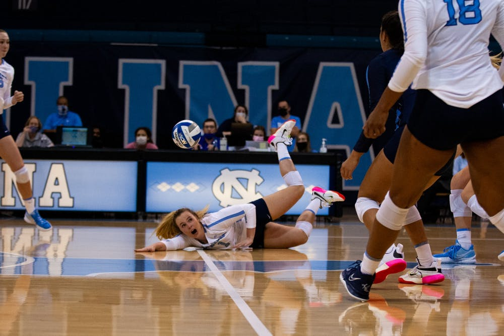UNC graduate setter Meghan Neelon (1) passes a successful pancake to her teammates. In an intense match, the Tar Heel volleyball team defeated Colorado State 17-15 in an overtime set.