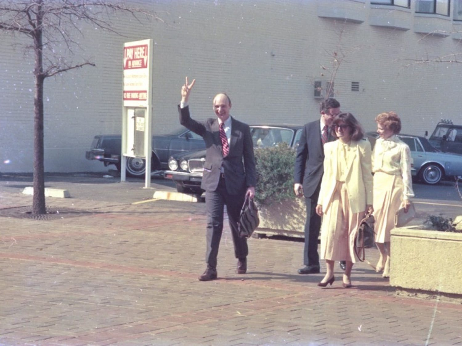Walter Hussman Jr. walks out of a Little Rock, Arkansas, courthouse in March 1986 after being exonerated by a federal jury of all charges alleging predatory business practices in an antitrust lawsuit by his rival newspaper. Photo courtesy of Walter Hussman Jr.