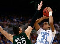 UNC forward John Henson is defended by an Ohio forward in the Tar Heels' 73-65 overtime win at the Edward Jones Dome in St. Louis in the Sweet 16 of the 2012 NCAA Tournament. (DTH File/Stephen Mitchell)