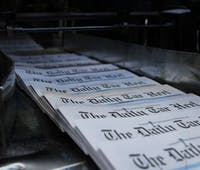 Newspapers come off the press to be bundled for delivery. DTH/Chris Conway