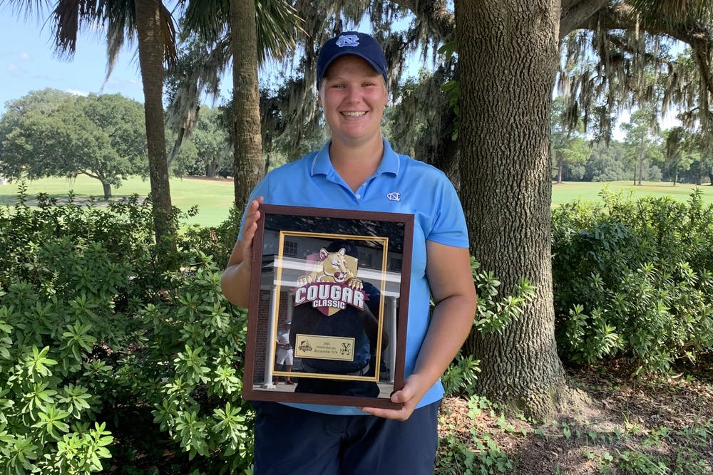 Krista Junkkari holds her second-place trophy at the Cougar Classic on Sept. 14, 2021. Photo Courtesy of UNC Athletic Communications.