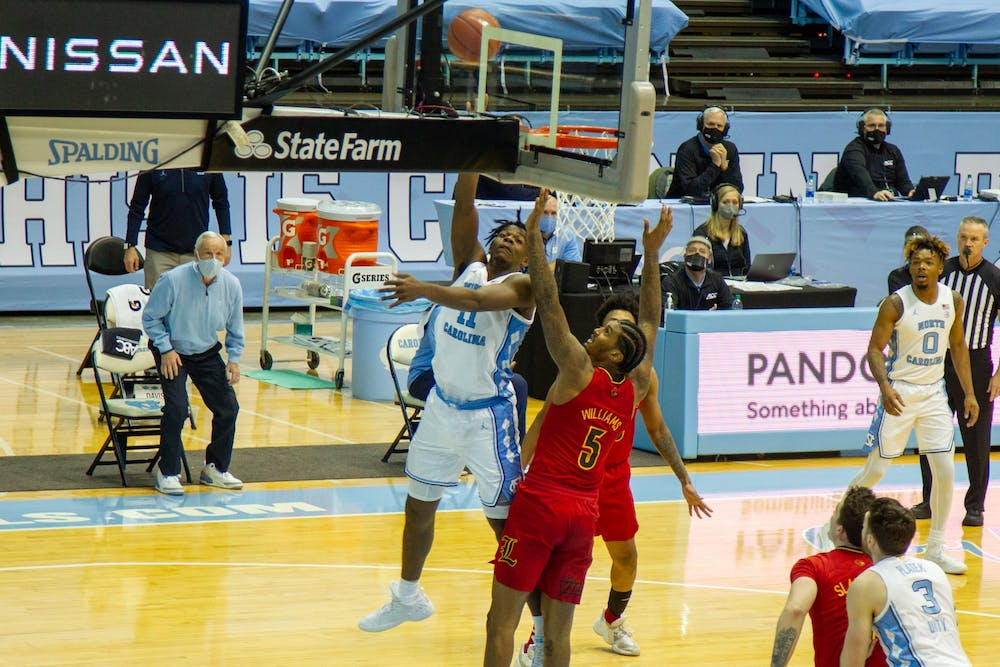 UNC first year forward Day'Ron Sharpe (11) shoots the ball at the game against Louisville on Saturday, Feb. 20 2021 at the Smith Center in Chapel Hill. UNC won 99-54.