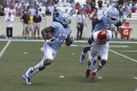 Wide receiver Anthony Ratliff-Williams (17) returns a kick against Louisville on Saturday.