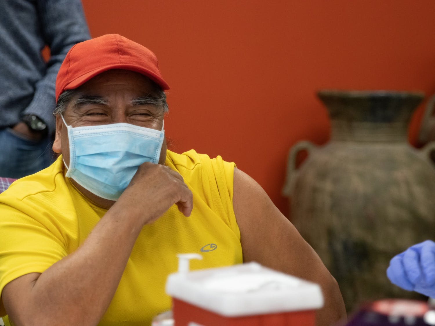 Rocendo Rosas, an immigrant originally from Oaxaca, Mexico, laughs as he waits to receive a COVID-19 vaccine at La Semilla's vaccination event, Feb. 20, 2021.