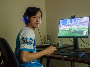 Jason Hu, a senior computer science and statistics double major and member of the UNC Rocket League Club poses in front of his computer on Wednesday May 19, 2021.