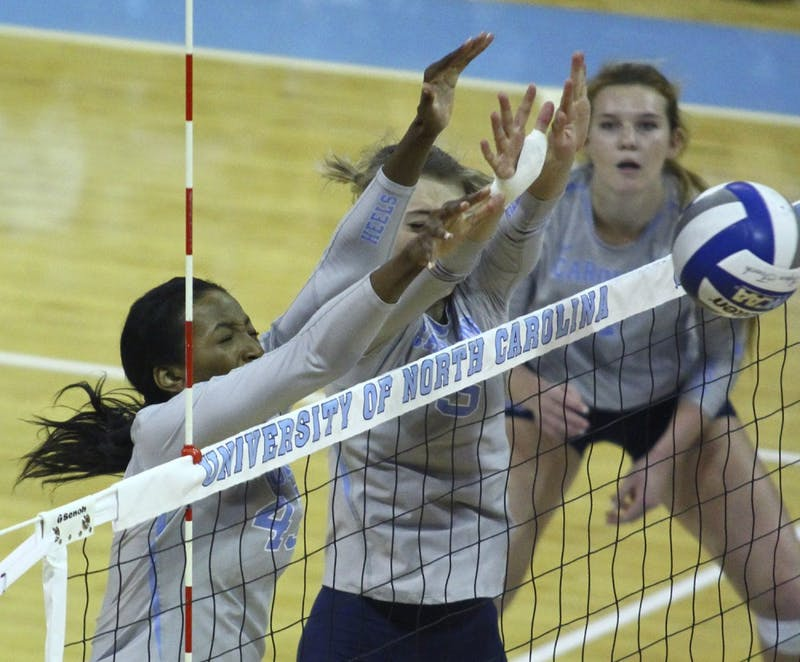 UNC outsidehitter Taylor Leath (43) (left)and middle hitterTaylor Fricano (5) go up for a block against N.C. State on Wednesday.