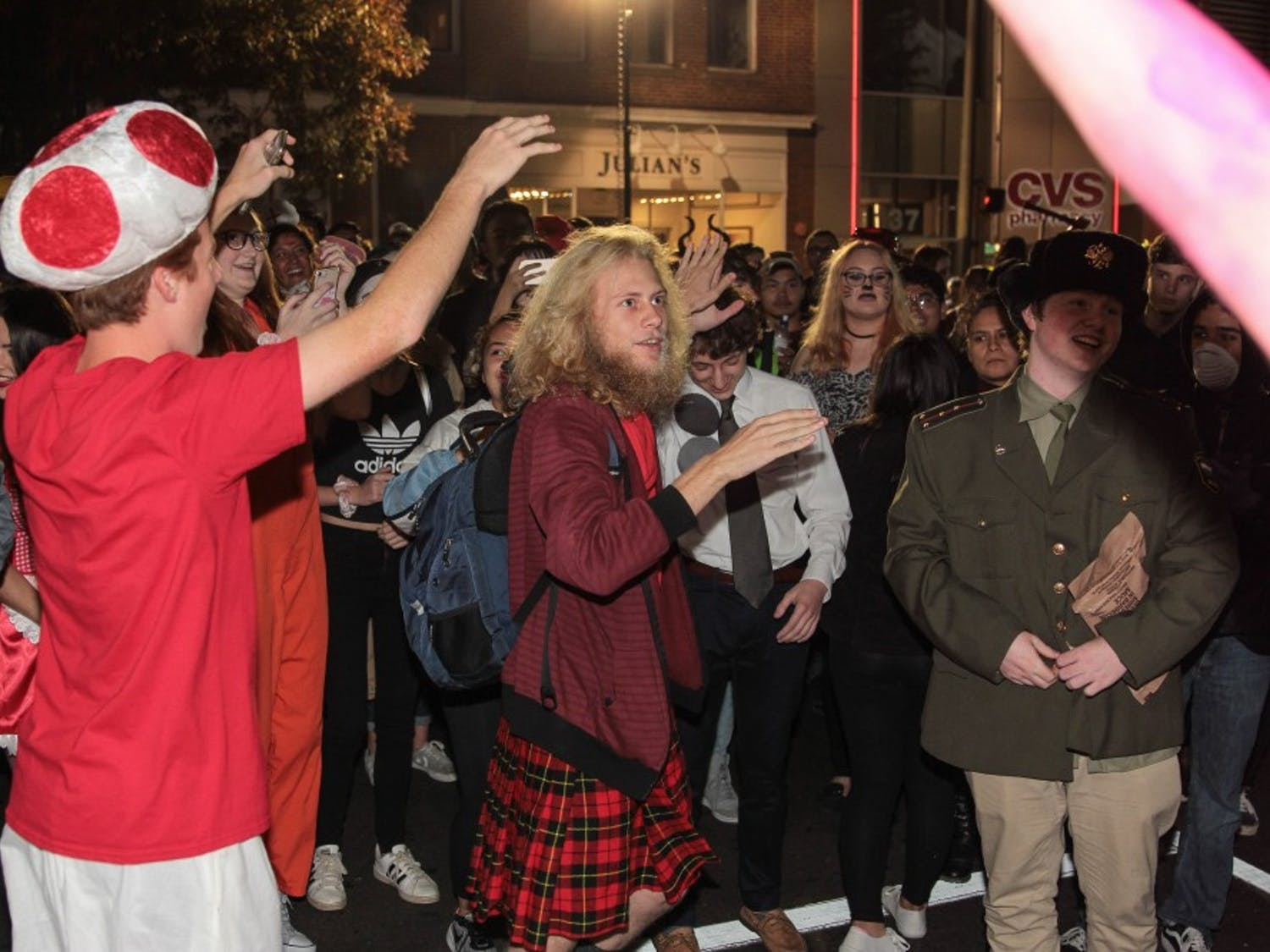 First-year Clayton Covington high-fives people on Franklin Street.