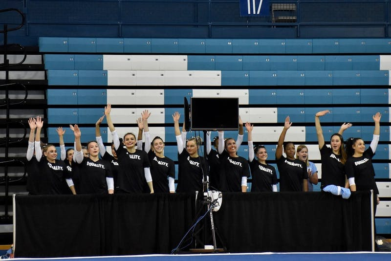 The North Carolina gymnastics teams waves to the crowd during its Equality Meet on Jan. 19 in Carmichael Arena.