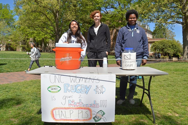 The Women's Rugby team is going to the national championship game but has to raise the money to get there. Kenya Hairston(left), a Psychology major from Class of 2017, Bridget Sheridan(middle), a freshman majors in Biology, and Amy Alam(left), double major in Psychology and Biology from Class of 2018, are raising the money for their team on campus on Apr.5.