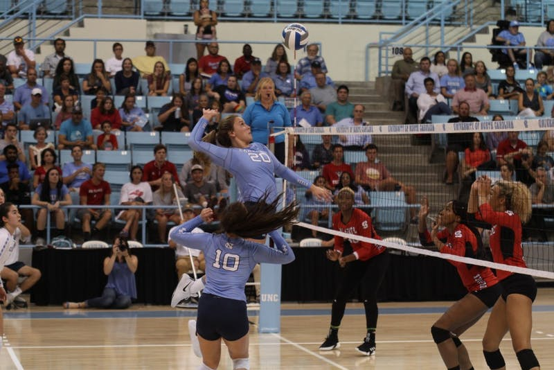 Ava Bell, freshman and middle blocker for UNC's women's volleyball team, jumps for the ball in a game against N.C. State on Wednesday, Sept. 26, 2018.
