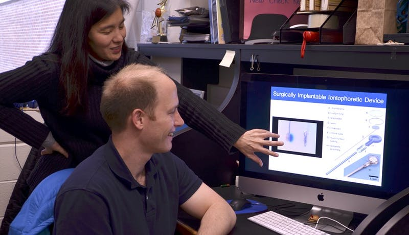 Associate professor of oncology Dr. Jen Jen Yeh and medical student James Byrne, Ph.D., in Yeh's lab in Lineberger Cancer Center. Yeh and Byrne worked together on a team of researchers to create a new device to treat pancreatic cancer directly at the site of the tumor.